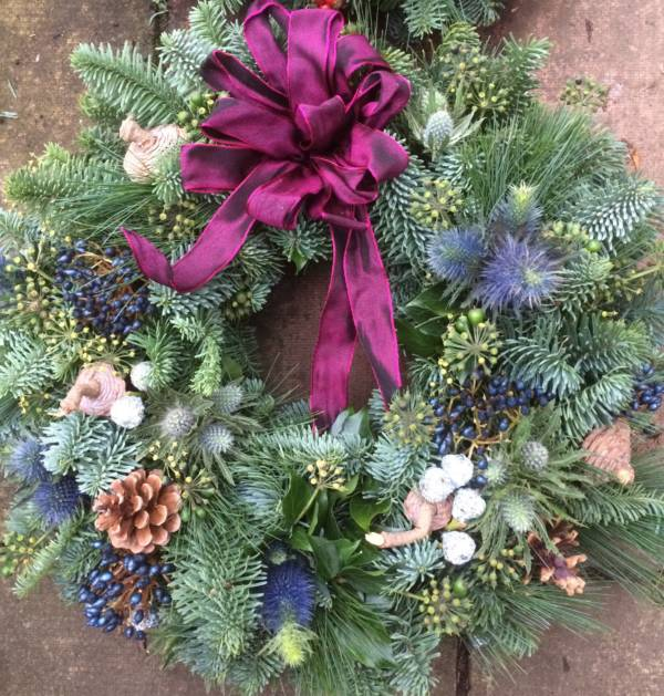 natural Christmas door wreath with fresh pine and mulberry bow