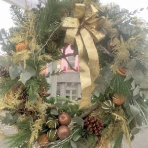 large Christmas door wreath with gold embellishment. Waxed apples, dried limes and oranges and much more